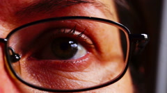 Closeup of woman's face and eye with glasses, lachrymose Stock Footage