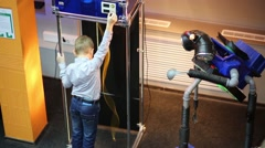Boy with an exhibit in interactive museum in center for children Stock Footage