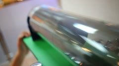 The ball rolls from one end of the transparent pipe in another Stock Footage