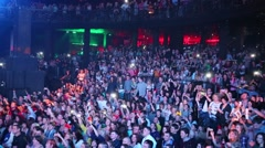 Many viewers in the large hall at the of a night club Stock Footage