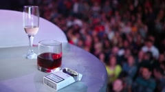 Two glasses and a pack of cigarettes on the table against Stock Footage