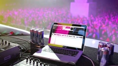 Laptop and DJ bar on the background of performance of the singer Stock Footage