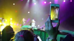 Female hand with telephone relieves concert at a party Diskach 90th Stock Footage