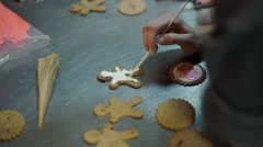 Hands Decorating christmas cookies with selective focus and place for text Stock Footage