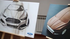 Row of stands with illustrations at press event for Ford Stock Footage
