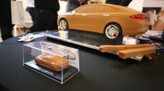 Little clay model of the car in a glass box is on the table Stock Footage
