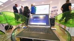 Laptop stands on a glass table in the hall in SREDA loft Stock Footage