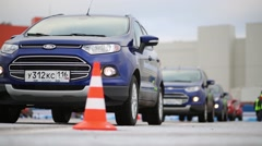 Bright clean cars Ford stands behind one another on training ground Stock Footage