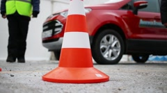 Orange traffic cone on the training ground on a background of car Stock Footage