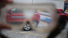 A view through the glasses simulate a drunk driver on cars Stock Footage