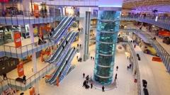 Escalators and a huge aquarium in shopping center Aviapark Stock Footage