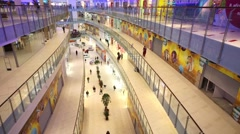 A long corridor with several floors in shopping center Aviapark Stock Footage