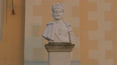 Bust statue of King Ferdinand in front of the Coronation Cathedral in Alba Iulia Stock Footage