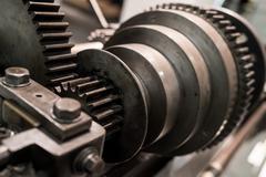 Spinning cog wheels - stock photo
