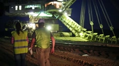 Two workers are going across the sand career stacker. Stock Footage