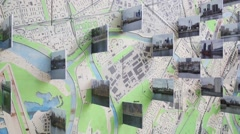 Close up view the map with a many pictures cityscape on Festival Stock Footage