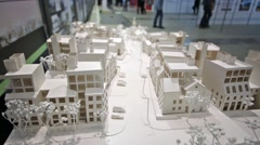 Stock Video Footage of Architectural model from white paper on the exhibition.