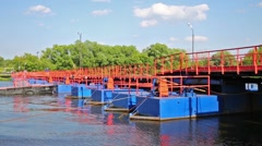 Stock Video Footage of The pontoon bridge and river at sunny bright day in summer.
