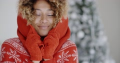 Cute young African woman in winter fashion - stock footage