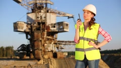 Female worker looks on a background of career Stacker. Stock Footage