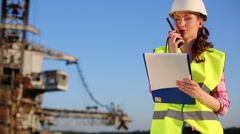 Female worker talking on a radio in career Stacker. Stock Footage