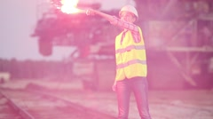 A female worker lights signal torch on the railways. Stock Footage