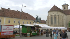 People passing by street stalls in the fortress of Alba Iulia Stock Footage