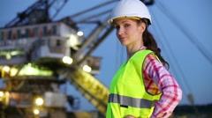 A female worker going to sandpit on career stacker. Stock Footage