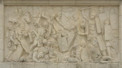 Bas-relief of soldiers fighting in a war in Alba Iulia fortress Stock Footage