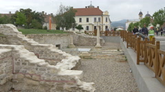 People walking by archaeological ruins in Alba Iulia fortress Stock Footage