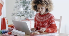 Young woman doing Xmas shopping online Stock Footage
