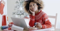 Young woman pondering over an online purchase Stock Footage