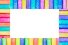 Row of rainbow colored chalk isolate on white background - stock photo
