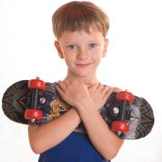 the boy are engaged in a skateboarding - stock photo