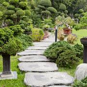 Stock Photo of Landscaping in the garden. The path in the garden.
