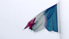 Old & spoil french flag floating in wind cloudy grey sky. Close up, slow motion Stock Footage