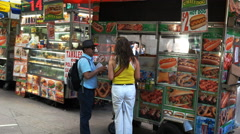 Customers buying food from a food truck, new york Stock Footage