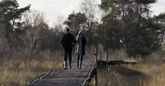 Happy young couple National Park walking bat bridge Stock Footage