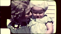 Pretty Blonde Young MOTHER Holds BABY Girl 1930s Vintage Film Home Movie 8600 Stock Footage