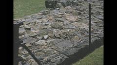 Vintage 16mm film, 1965, North Ireland ancient stone wall Stock Footage