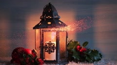 Christmas lantern with Holly leaves and berries. - stock footage