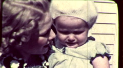 Pretty Blonde Young MOTHER Holds BABY Girl 1930s Vintage Film Home Movie 8601 Stock Footage