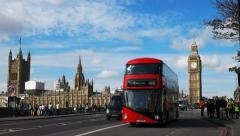 a double decker bus with big ben in london, uk - stock footage