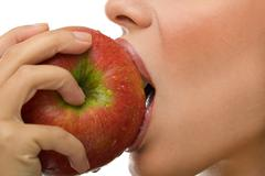 healthy woman eating apple - stock photo