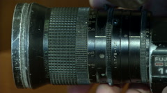 The camera lens is on the side and fingers - stock footage