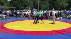 Tatar national fight Kuresh during the Sabantuy celebration in Samara, Russia - stock footage