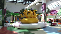 Children playing on the playground in a shopping center Stock Footage