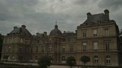 Establishing shot of Luxembourg Palace at dusk Stock Footage