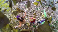 Happy children throwing leaves in Autumn in slow motion. Aerial Slow Motion 1 Stock Footage
