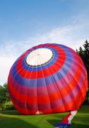 Filling up a red hot air balloon Stock Photos